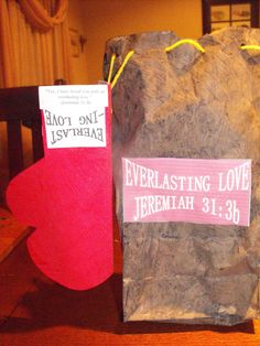 """EVERLASTin gLOVE Valentine and (heavy) goody bag.... The Scripture used on the bag and glove is Jeremiah 31:3b: """"Yes, I have loved you with an everlasting love.""""  Inside is a Gospel Tract I wrote for Tract-or Treat 2010, a poem I wrote Feb. of 2010 (My Valentine, go to lifeinthemotherhood.wordpress.com click on """"My Songs and Poetry"""") and two additional verses: In this the love of God was manifested toward us, that God has sent His only begotten Son into the world, that we might live through Him. In this is love, not that we loved God, but that He loved us and sent His Son to be the propitiation for our sins. Beloved, if God so loved us, we also ought to love one another. -1 John 4:9-11 and But God demonstrates His own love toward us, in that while we were still sinners, Christ died for us. –Romans 5:8 the glove is attached by yarn that is laced up in the back, and threaded through holes in the paper bag (with use of hole punch)..."""