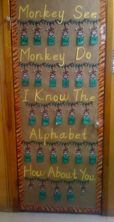 I really liked the Monkey See Monkey Do Bulletin Board. I found the monkey swinging from the vine coloring sheet and added some alphabet flash cards to each monkey. I covered my door with brown paper and put a border around it then stapled everything down.