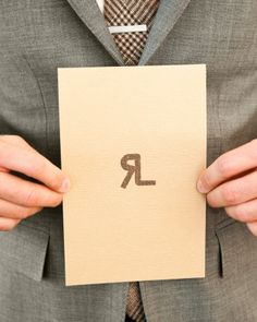 Ink initials on the back of each program mimic the cattle brand this groom's father made