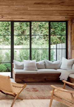 that couch + those chairs + salvaged barn wood walls and ceiling