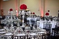 fancy black and white reception with red roses