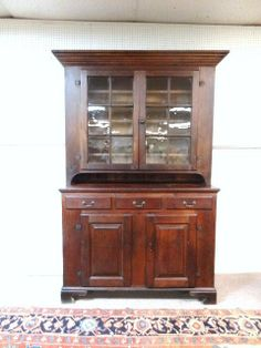 Sold $4,250 Late 18th Century original Pennsylvania Butternut 2 piece  Dutch cupboard w/old finish, original glass & hardware, top measure 60 in. (w) at...