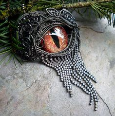 """By Twisted Sister Arts, this """"evil eye"""" pendant is perfect """"wow"""" for a goth or steampunk outfit."""