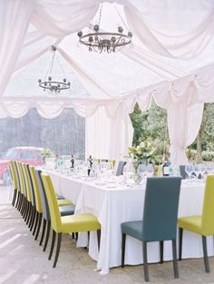 clear tent + white draping + chandeliers + green/grey chairs // wedding reception inspiration wedding tables, wedding receptions, tent wedding, color, wedding blog, wedding chairs, outdoor weddings, parti, destination weddings