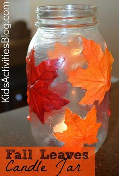 decoupage candle - made out of colorful leaves.  A fun DIY craft that the kids can make
