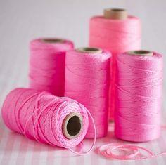 . Pink yarn spools