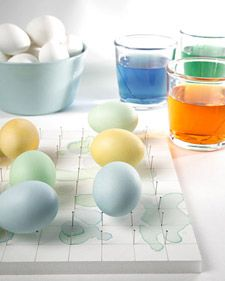 Foam board w/ pins to hold dyed eggs while drying them. Clever.