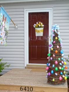 I like the grapevine tree covered in Easter Eggs for my porch.