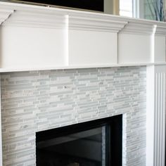 modern tile with a traditional mantel.