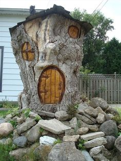 front view, tree stumps, little houses, tiny houses, tree houses, fairy houses, fairi, hobbit houses, guest houses
