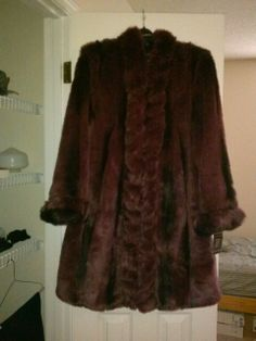 3/4 lenghth maroon tags still attached paid $ 400 asking $200 ! Call 843-901-2062