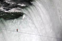 Tightrope walker over falls