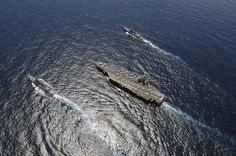U.S. Navy ships are in the Atlantic Ocean. by Official U.S. Navy Imagery