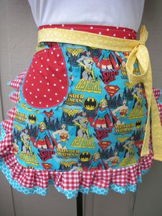Super Hero Apron - Wonder Woman, Bat Girl & Super Girl.  For the mom of a boy.  :)  Super cool. Aaaaa! I want this one to wear for my Walter.