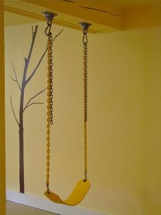 A swing set up in a basement playroom. Great in the winter!