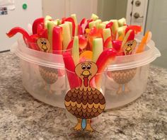Thanksgiving turkey veggies and dip snack idea. I made these for my daughter's daycare potluck lunch. Put dip in bottom of any small cup add spears of colorful veggies (I used orange and red peppers and cucumbers). Tape a pic if a turkey (google turkey clip art) to cup and have fun.