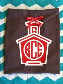 Schoolhouse monogram tee accented with a ribbon!  Ribbon will vary depending on availability.