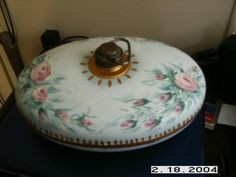 an old bed warmer that I painted with mint and roses
