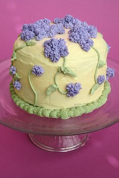 A beautiful floral cake in contrasting lilac and pale yellow...