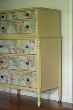 Painted chest of drawers with colorful maps applied to the drawer fronts.