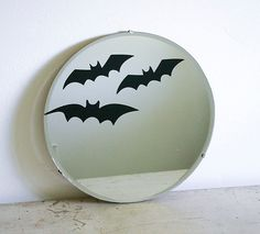 We love this simple idea for dressing up a vintage mirror for Halloween. #MarthaStewartLiving