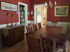Red walls in the dining room make a beautiful accent to our mission style furniture.   Classic Shaker Table with American Mission Style Dining Chairs. Both shown with Autumn Cherry Stain. Table: http://vermontwoodsstudios.com/products/boat-top-shaker-table Chairs: http://vermontwoodsstudios.com/products/american-mission-chair