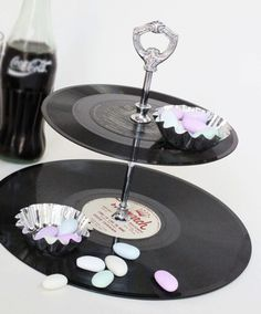 Vinyl records used as serving pieces -- DIY. (Caveat: I'd do something like with with unplayable records, not still-good records!)