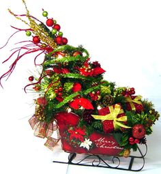 Festive Sleigh Christmas Tree Centerpiece Floral Arrangement by  Cabin Cove Creations on Etsy, $175.00 If sold please stop by the cabin and take a peek at all my other unique designs …click here… http://www.etsy.com/shop/cabincovecreations?ref=si_shop cabin, tree floral, sleigh christma, christma decor, christma tree, christmas trees