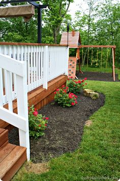 stained deck floor and top rail w/ white spindles