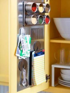 Use a sheet metal insert to turn the inside of a cabinet door into a convenient storage space with magnetic hooks, containers and clips. Click for 40+ more storage and organizing ideas! - Click image to find more diy & crafts Pinterest pins