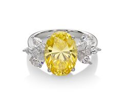 Monte Carlo Solei Ring   Platinum on Silver Oval Ring with Canary Yellow and White Stones $230