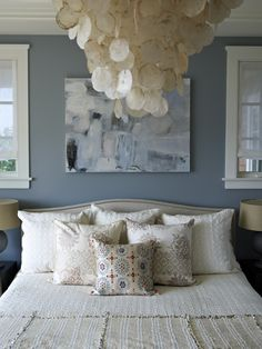 Blue & Cream Bedroom with Colette nailhead-trimmed bed, capiz chandelier, art over bed and cozy bedding - Burlington home by Bella Mancini Design