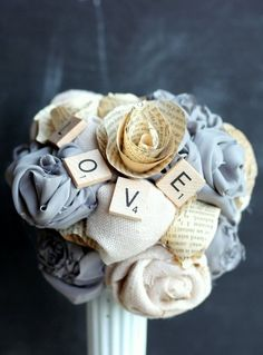 Bouquet with scrabble tiles and flowers made out of book pages.