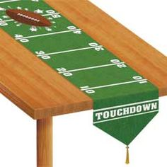 Football table runner. Would be really cute for a tailgate table decoration. #ultimatetailgate #fanatics