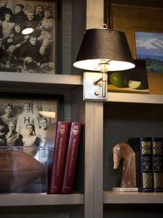 interiors by alice lane home collection   man's office, football, sconces, bookshelves, styled, bookends