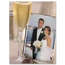 Put photos of your guests' wedding days on display at your wedding reception. You can print the photos at Kodak Picture Kiosk. #wedding #photography #ideas