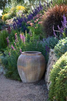 Garden on a slope and gravel path.