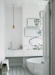 a mix of mirrors in this all white, luxe marble bathroom - so glam