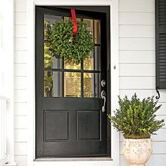 Charming Virginia Farmhouse | Farmhouse Detail: Oversize Front Door | SouthernLiving.com