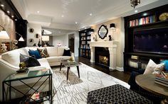 Love this room & how the TV blends into the wall.