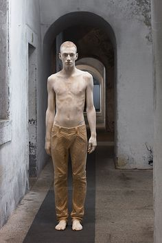 Bruno Walpoth uses simple carving tools to turn pieces of wood (lime and walnut) into human sculptures with detailed features that seen from afar look incredibly life-like#Repin By:Pinterest++ for iPad#