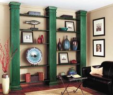 A trio of prefab porch columns joined together with simple shelving can add a stately look—and impressive display space—to any room. These unfinished oak columns were pretreated with Minwax Water Based Pre-Stain Wood Conditioner. Then, a coat of Minwax Water Based Wood Stain in Hunter Green was followed by Minwax Polycrylic Protective Finish in a semi-gloss sheen. | Photo: Courtesy of Minwax