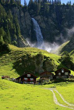 The tiny hamlet of Asch, Under the waterfall, Klausenpass, Switzerland