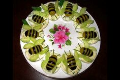 Little bees made out of black and green olives and a cucumber..