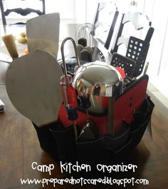 Camp kitchen organizer (a tool bucket) I suggest grabbing everything you use kitchen-wise . camping/glamping/SCA camping and putting it in a big pile. THEN go to the store for one of these, or make one, or what-have-you. Remember to get one big enough.