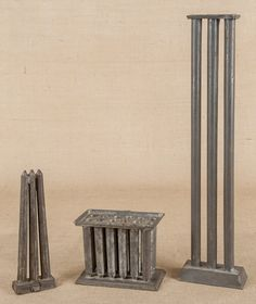 Sold $ 550 Three tin candlemolds, 19th c., tallest - 23 3/4''.