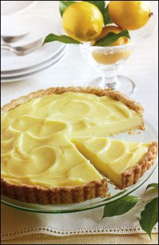 Copycat of La Madeline Lemon Tart ~~   The tart is basic—a great crust, with a velvety lemon cream -and profoundly satisfying.  You can add fresh raspberries around the outer edge for a spectacular display, as well as flavor.  You can also finish the tart with a meringue; or you can serve it with anything from whipped cream to raspberry coulis. See site for recipe.