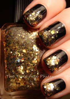 gold sparkles over black polish.. awesome