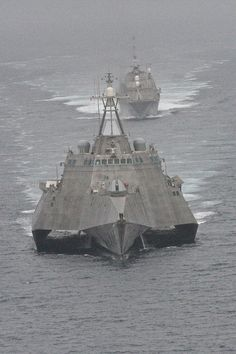 The first of class littoral combat ships USS Freedom and USS Independence maneuver together during an exercise off the coast of Southern California