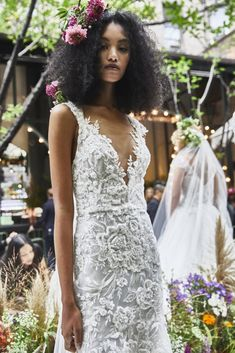 V neck embroidered wedding dress | Pin discovered by Kelly's Closet bridal boutique in Atlanta, Georgia